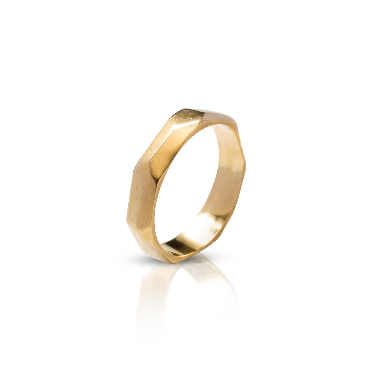 An asymmetric handmade gold band