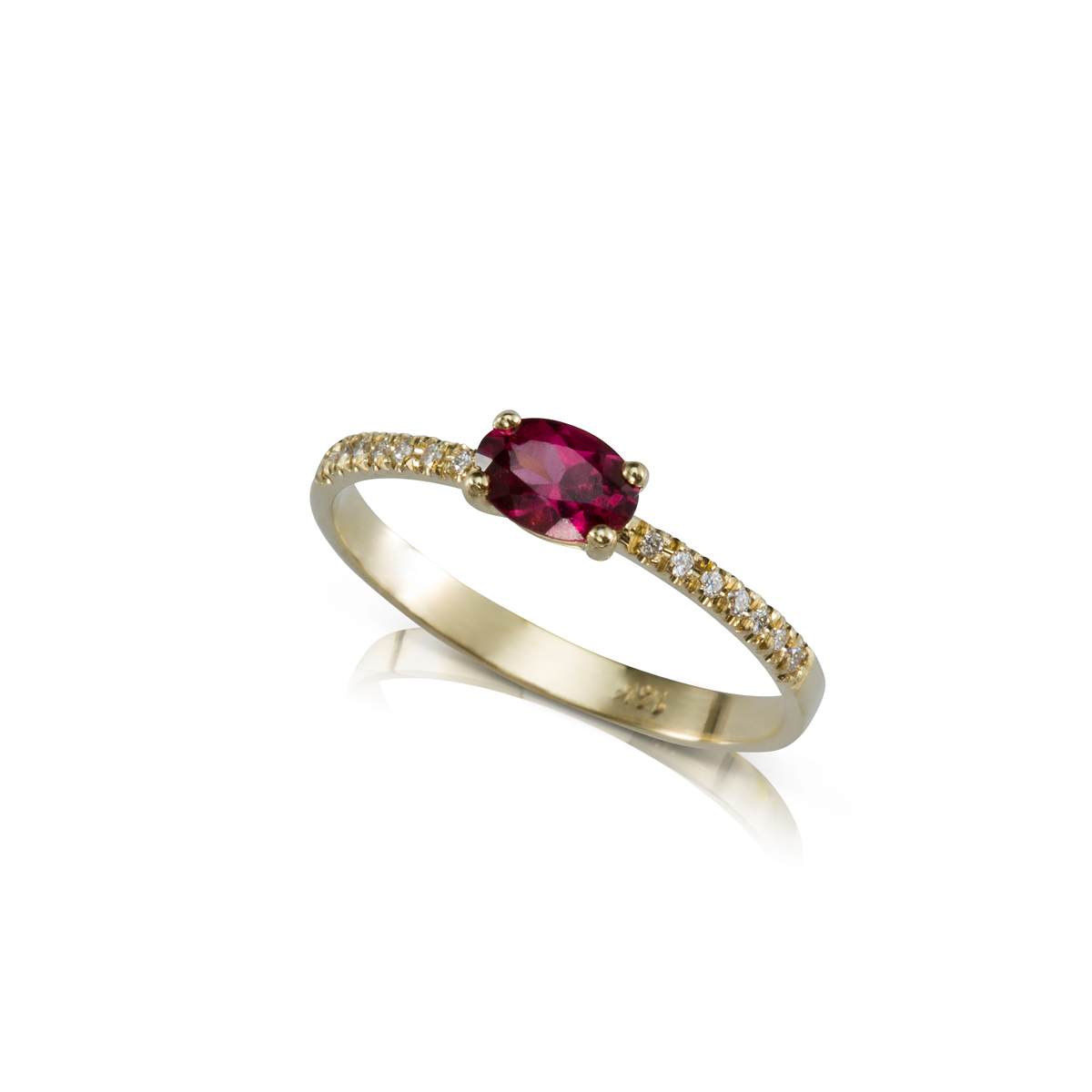 Solitaire ring set with an oval cut rhodolite