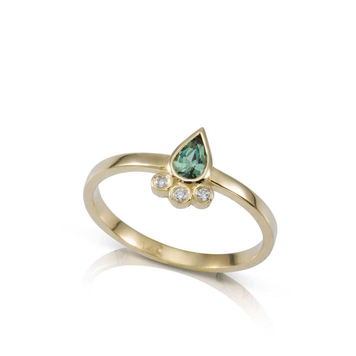 Gold ring with Pear cut green sapphire and diamonds
