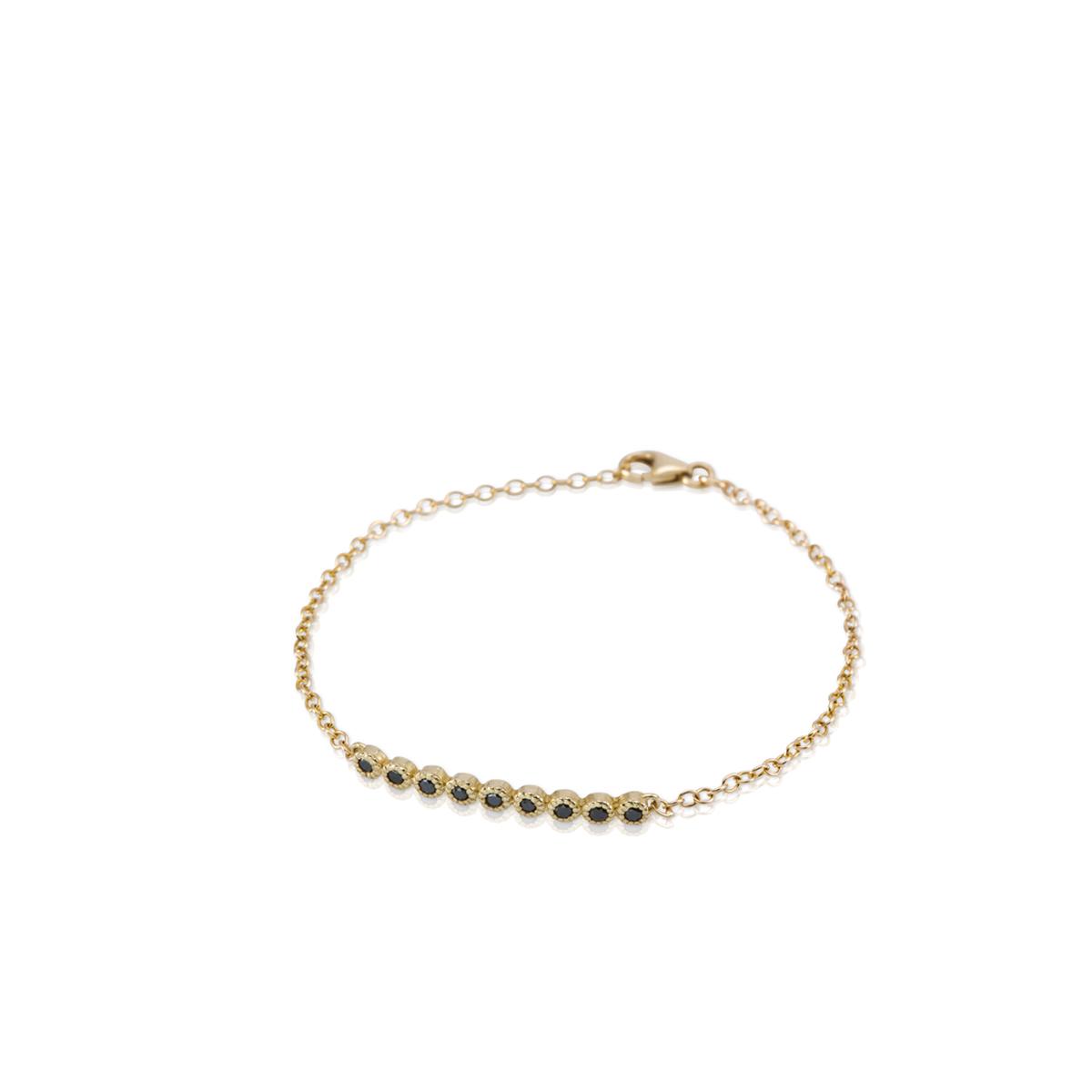 Gold bracelet set with 9 Black diamonds