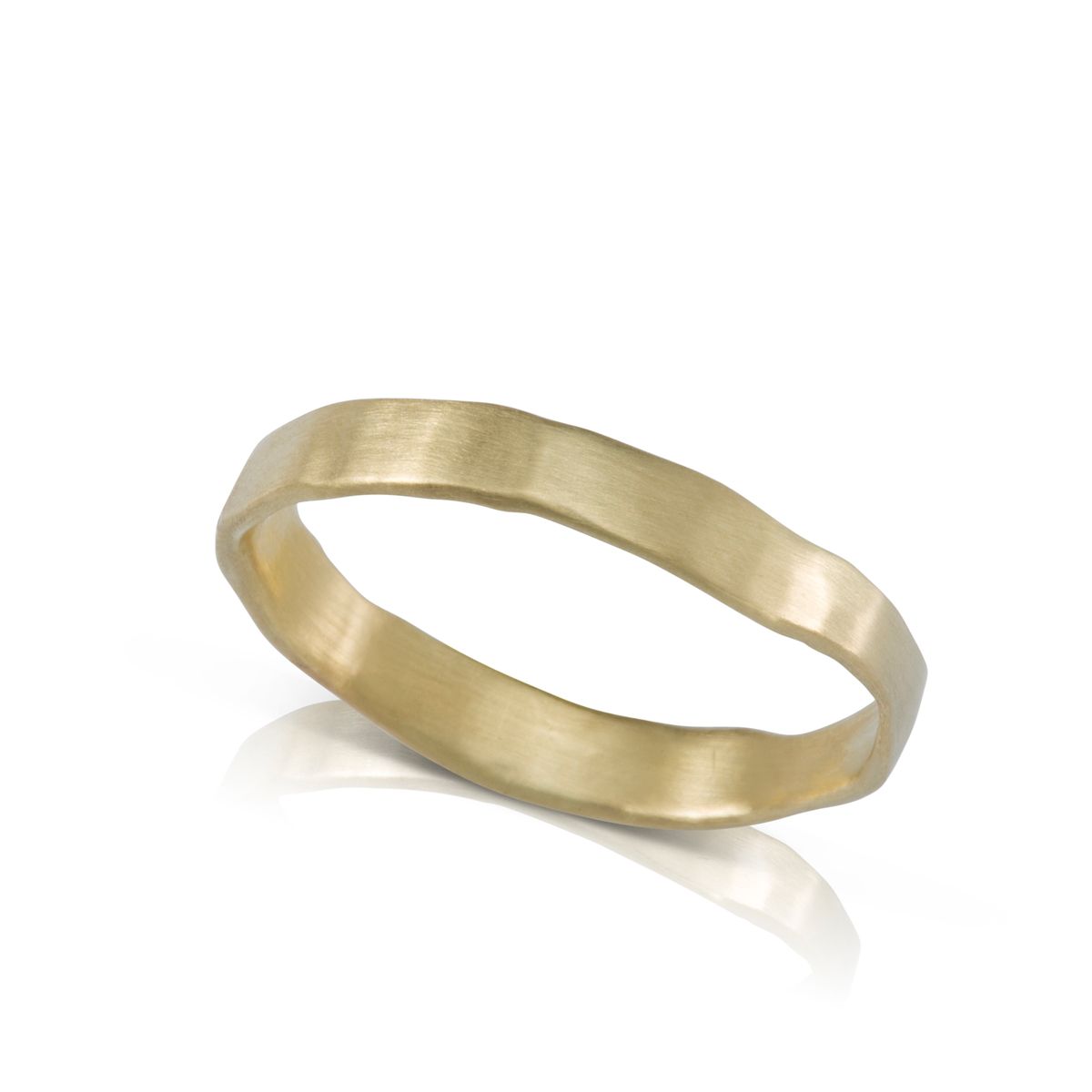 A gold ring in an asymmetrical handmade style