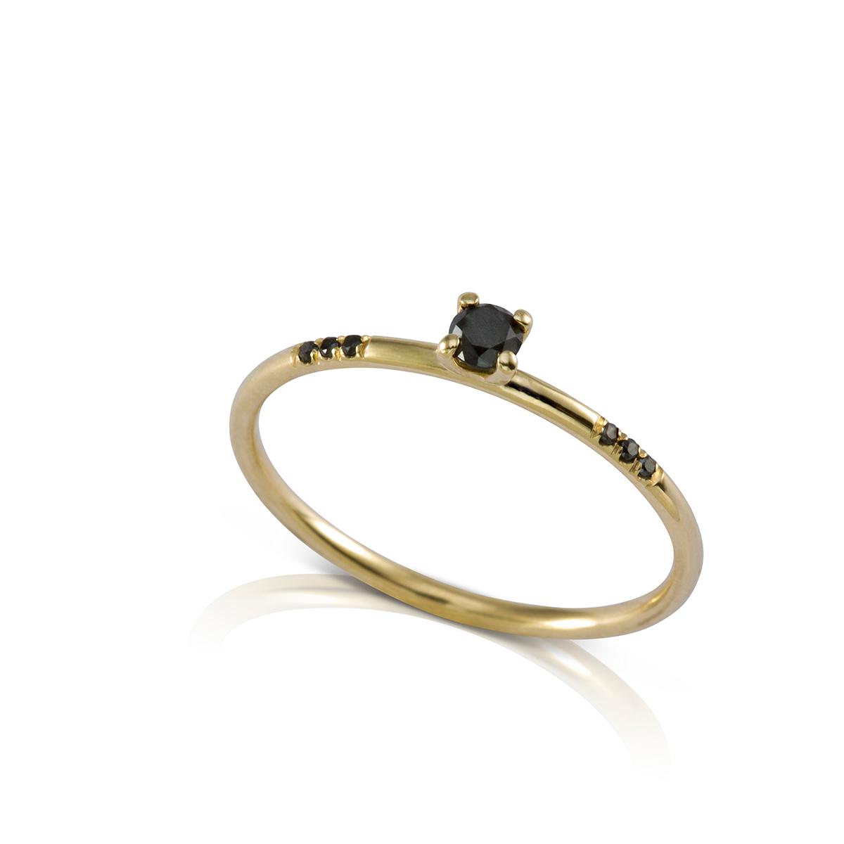 A delicate solitaire black diamond ring