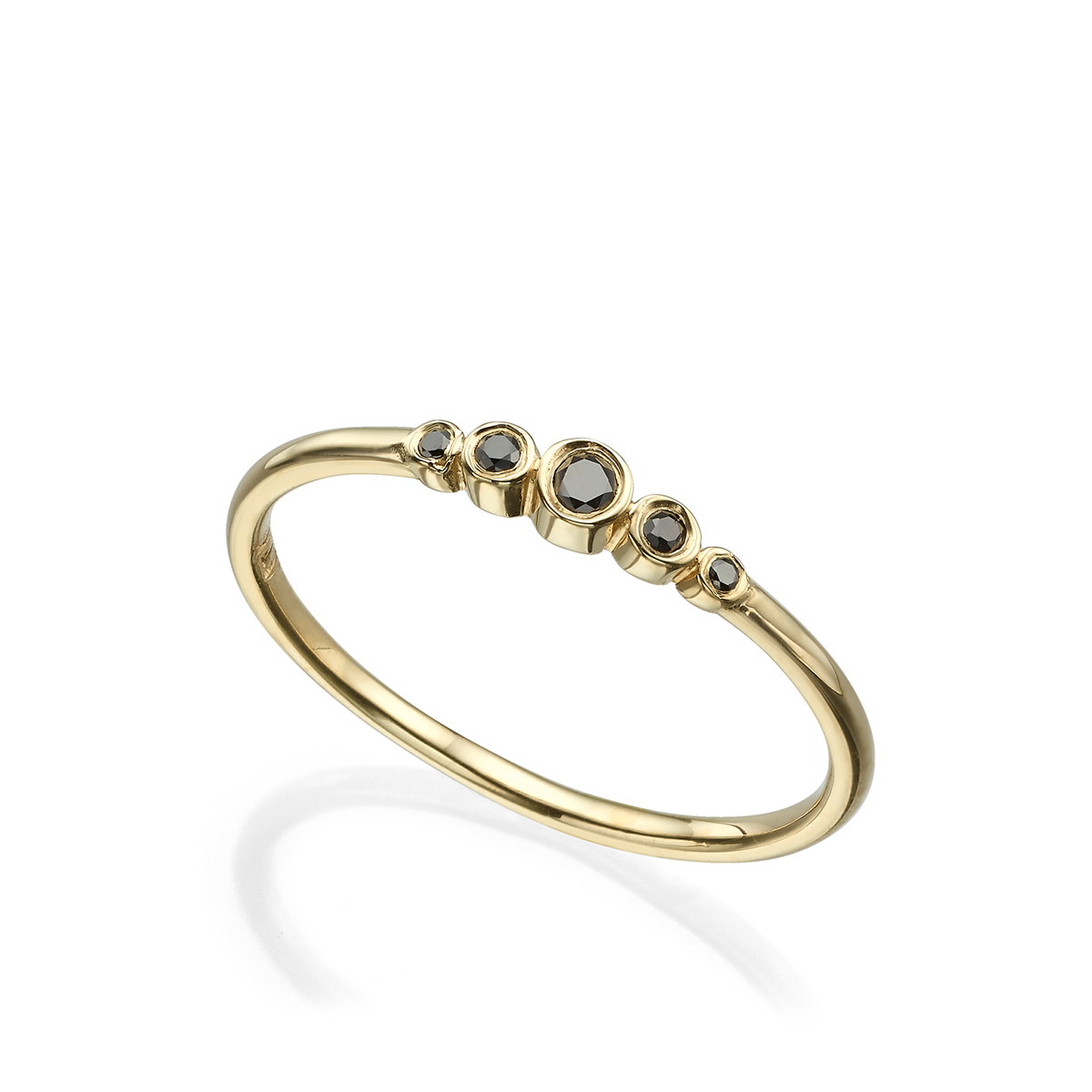 A delicate gold ring set with 5 black diamonds