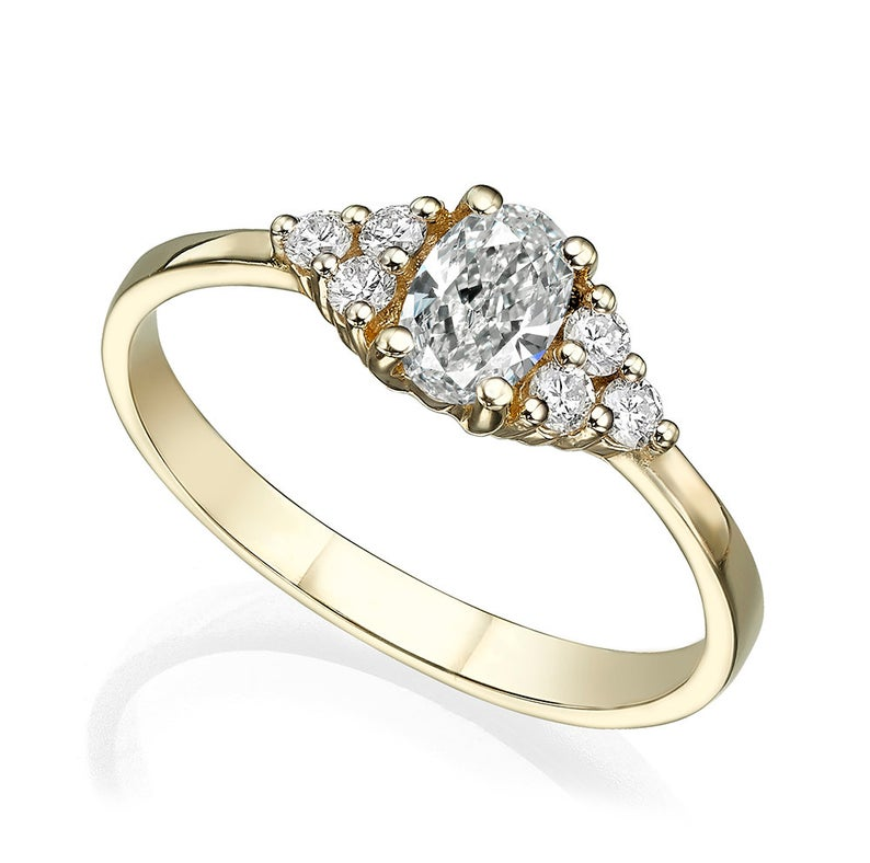 Center oval diamond with 3 round diamonds on each side total 0.58 Carat Engagement Ring
