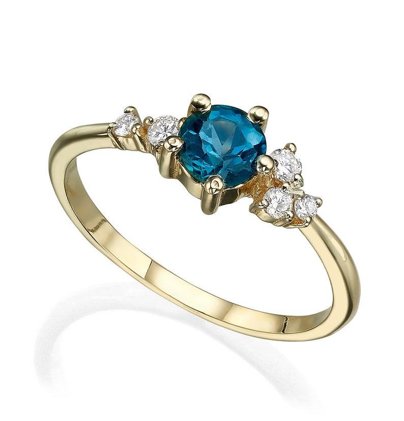Asymmetrical London blue topaz and diamonds engagement ring